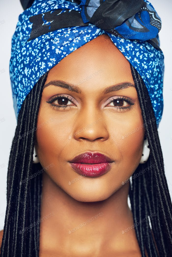 Young black woman with blue headscarf