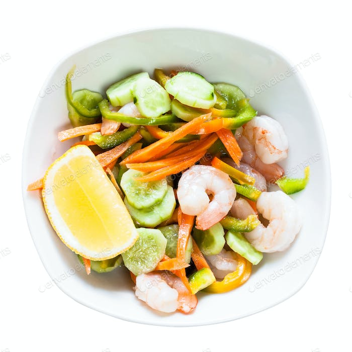 prawn salad from vegetables and shrimps in bowl