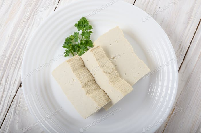 Soy Bean curd tofu on clay dish closeup. Non-dairy alternative s