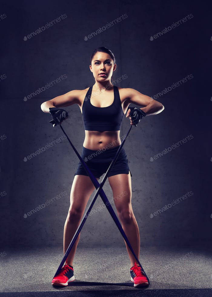 woman with expander exercising in gym