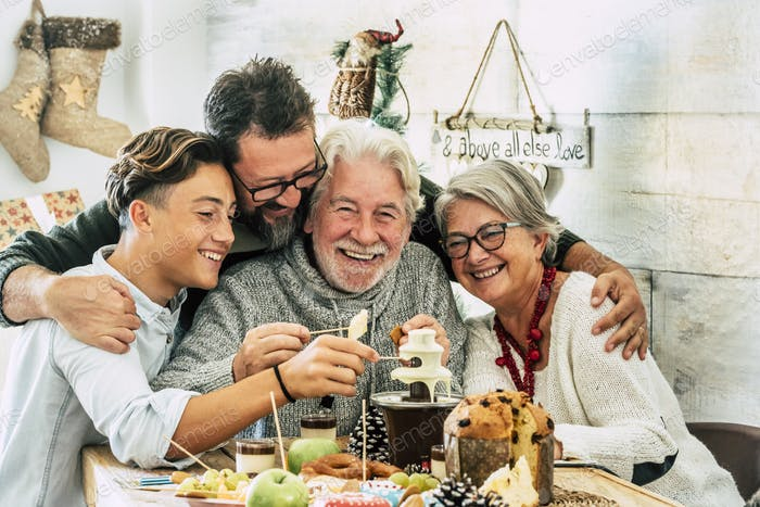 Cheerful and happy family enjoy together winter holidays and christmas lunch