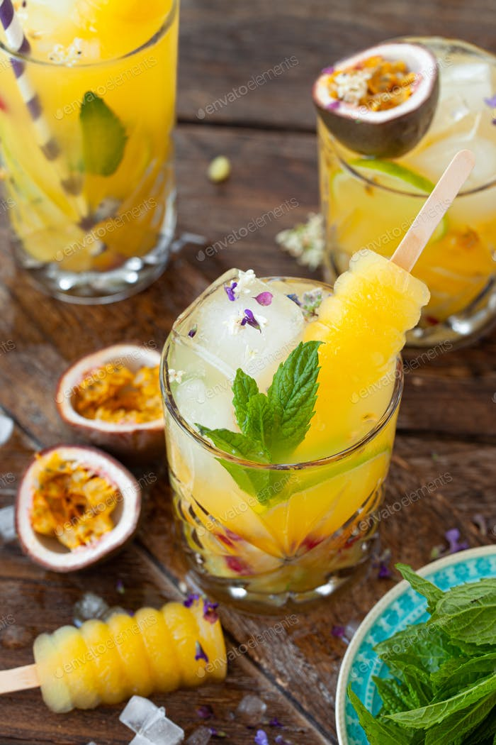 Ice cold cocktail with passion fruit