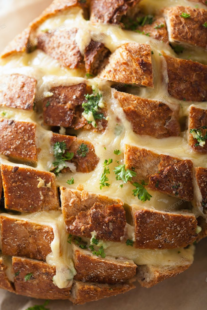 roasted party bread with melted cheese butter herbs