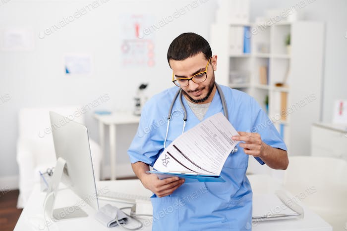 Middle-Eastern Physician in Office