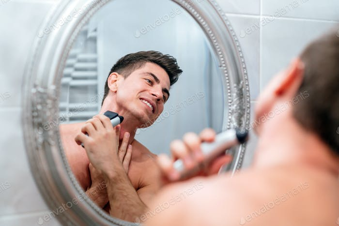 Man shaving in the morning