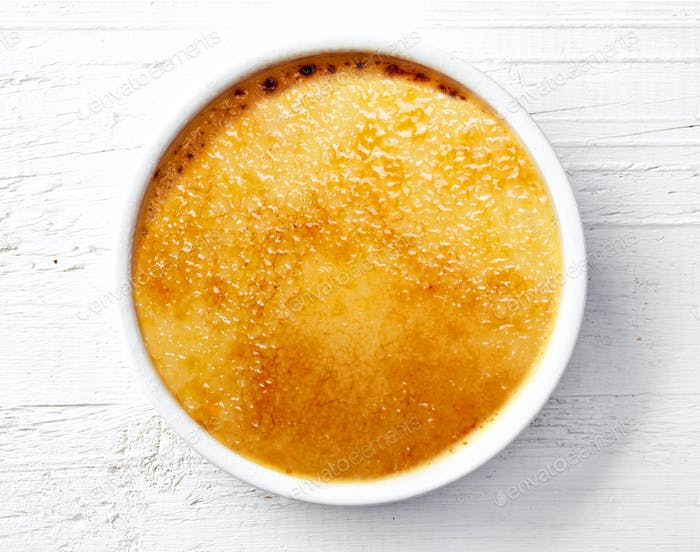 bowl of creme brule on white wooden table