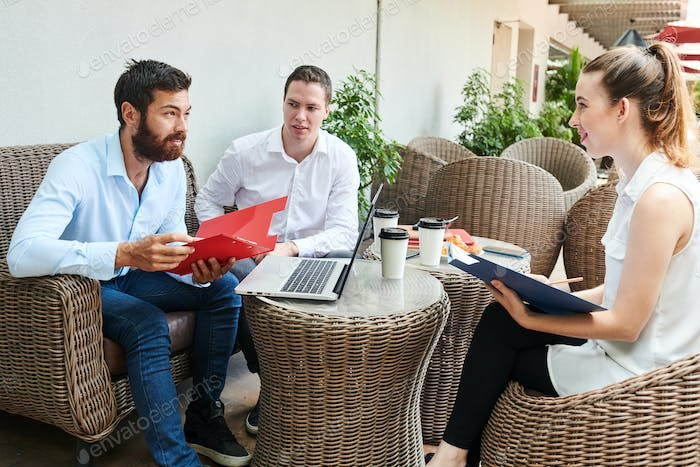 Business people listening to ideas on coworker
