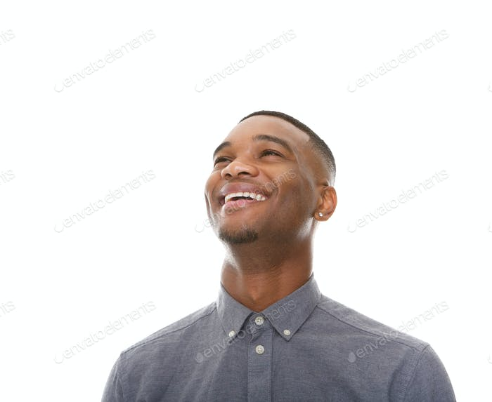 Close up portrait of a cheerful black man laughing