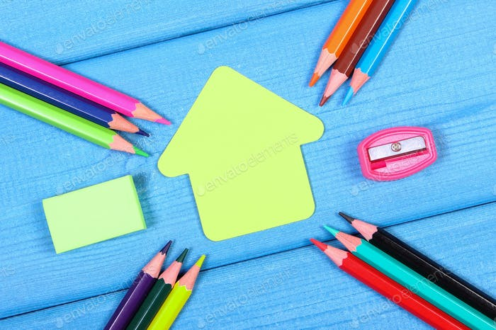 School accessories and shape of building on blue boards, copy space for text