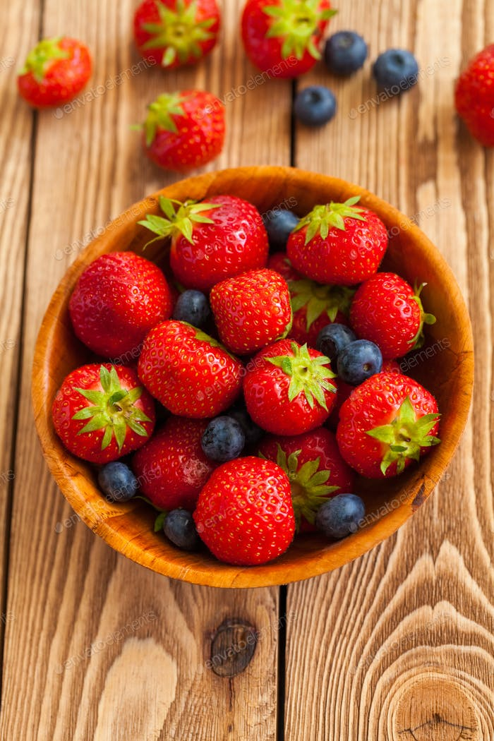 Berries on Wooden Background.