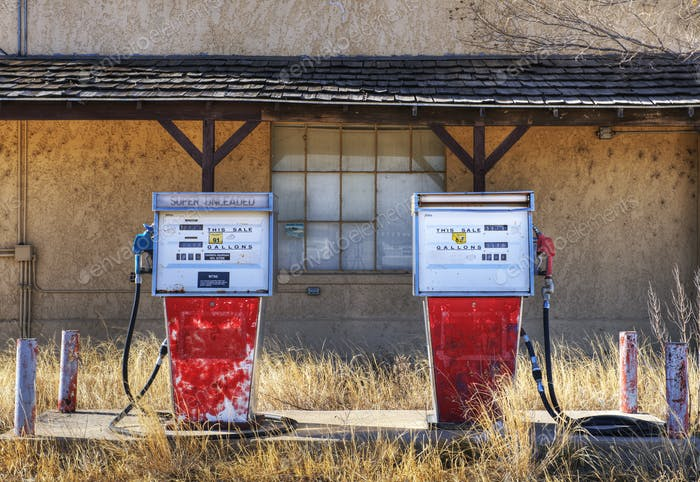 Gas pumps in an abandoned filling petrol station.