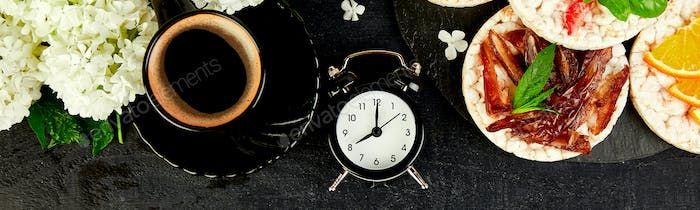 Banner with Alarm clock have a good day with a cup of coffee.