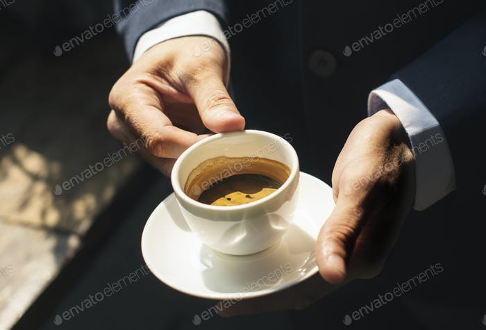 A businessman  having coffee