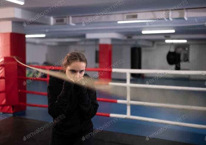 Aggressive boxer practicing on ring
