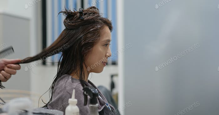 Woman making straight of the hair