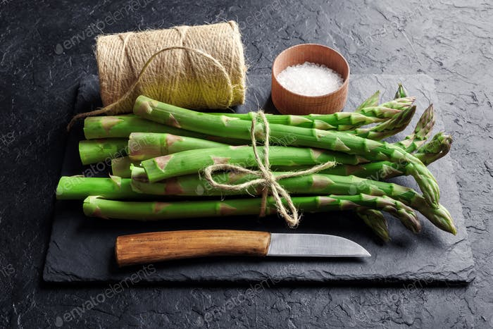 Green asparagus sprout with knife