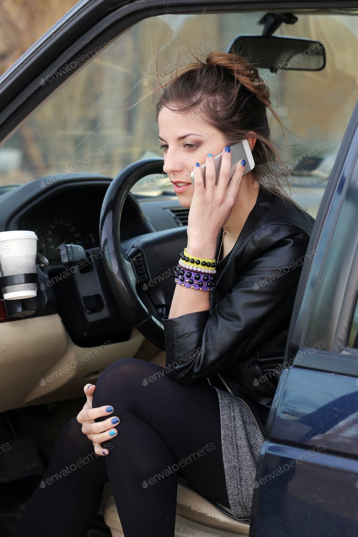 Attractive woman in the car