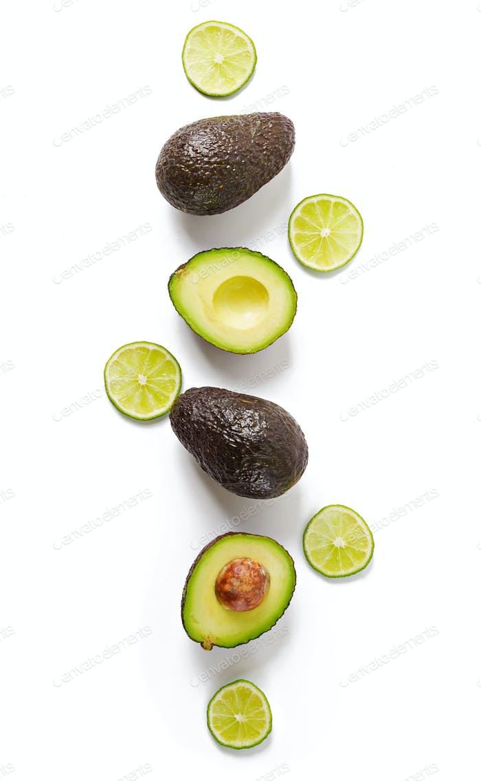 Avocado and lime isolated on white background. Top view