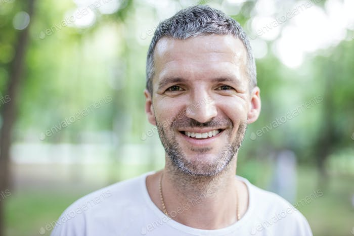 Portrait of happy attractive man outdoors