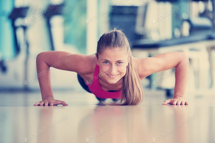 warming up and doing some push ups a the gym
