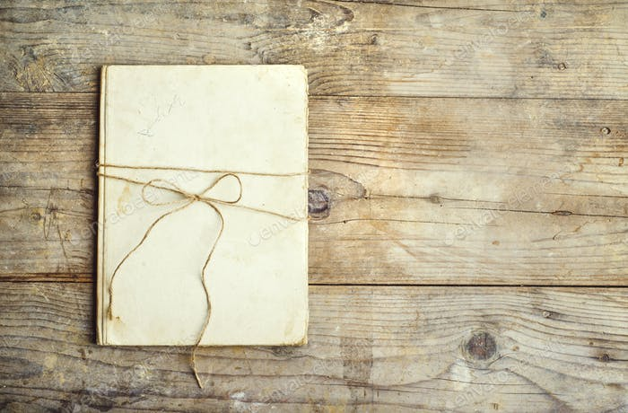 Old notebook on a wooden floor.