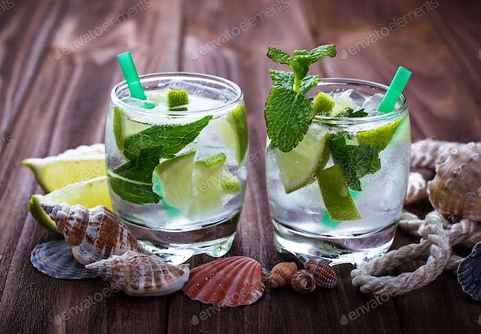 Cocktail mojito with rum, mint, ice, lime