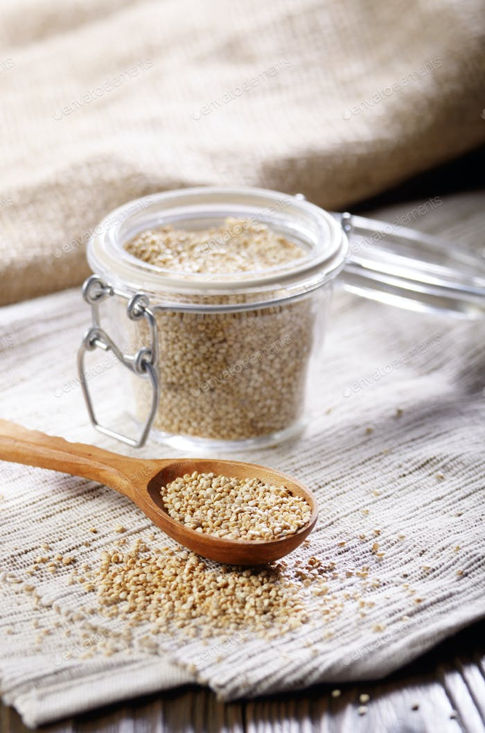 Raw organic superfood gluten free quinoa seeds in wooden spoon a