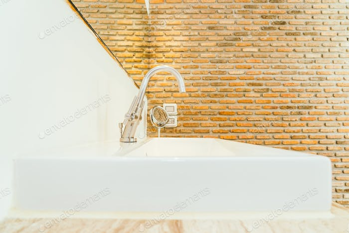 Faucet or water tap and white sink or washbasin decoration in ba