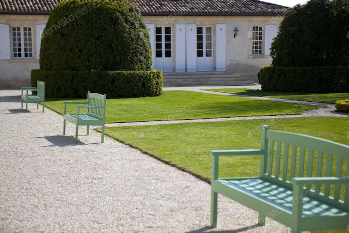 Green wooden benches