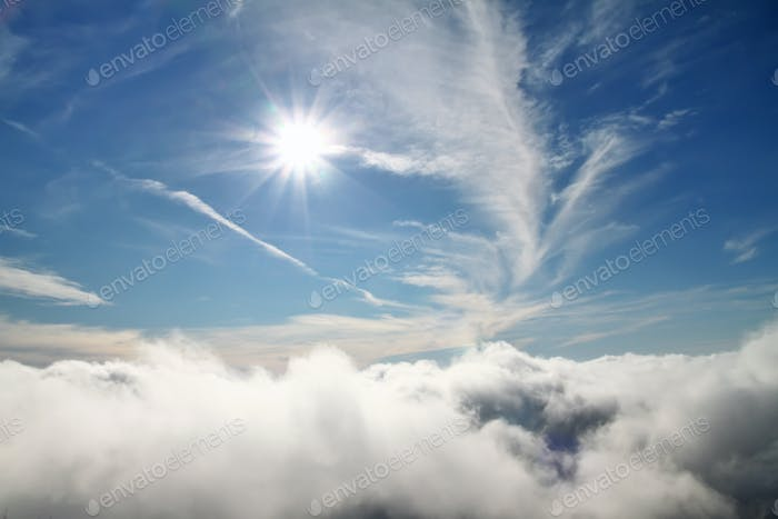 Blue sky sky with clouds and sun. Natural background concept