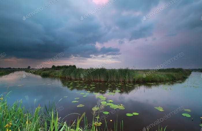 wild pond during summer storm