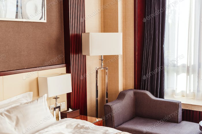 Hotel room interior with floor lamp.