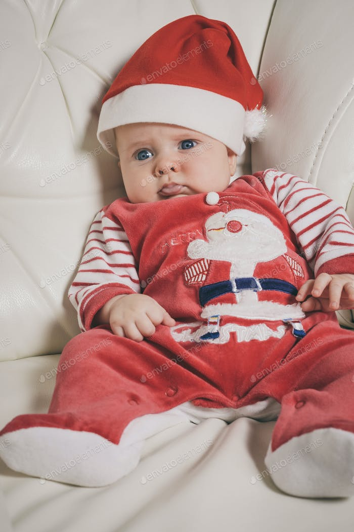 Happy  baby in Santa costume.
