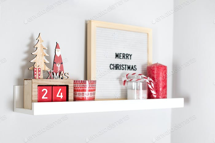 Christmas decoration collection on shelf in bedroom or living room. Christmas red holiday decor
