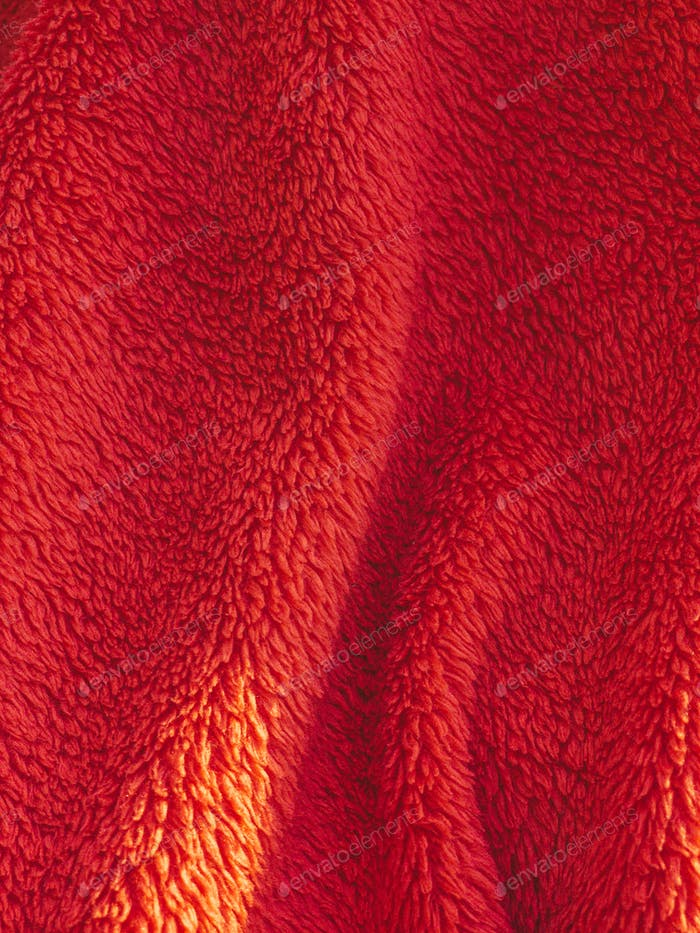 Red blanket texture on the sunlight