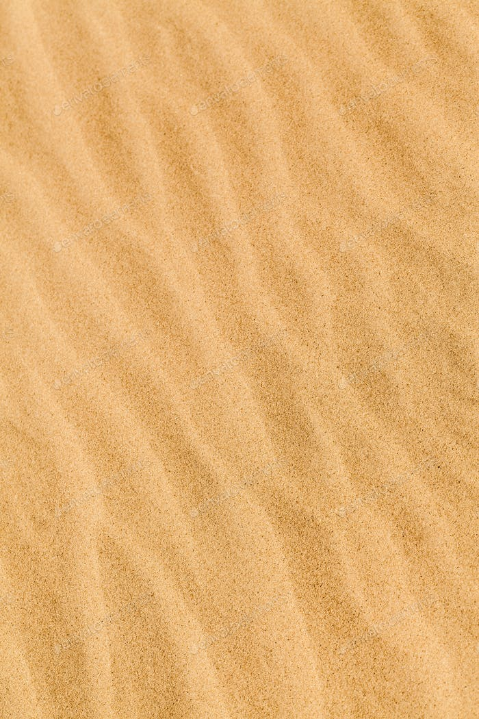 Yellow desert sand with diagonal wave patern