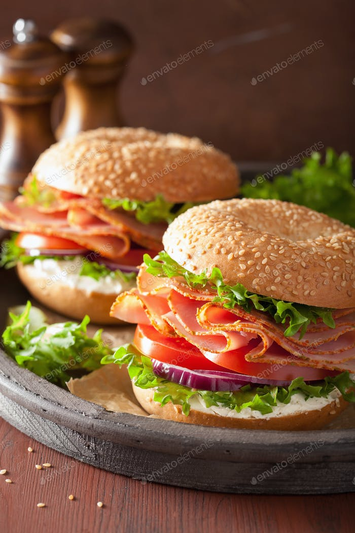 ham sandwich on bagel with cream cheese tomato onion