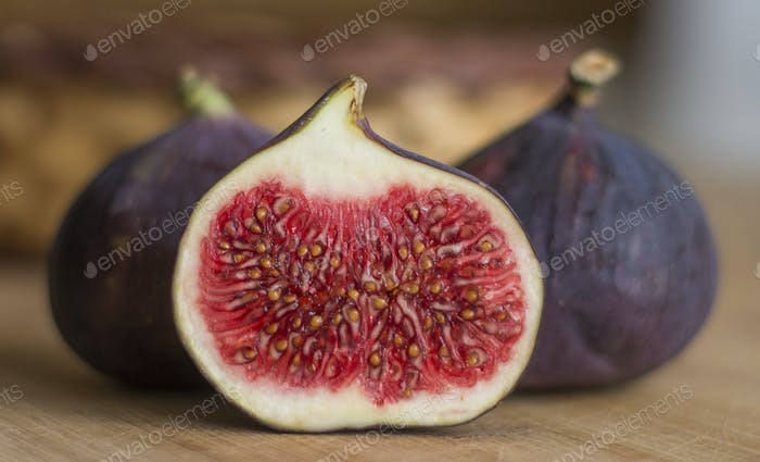 close up on the sliced fig, wooden background
