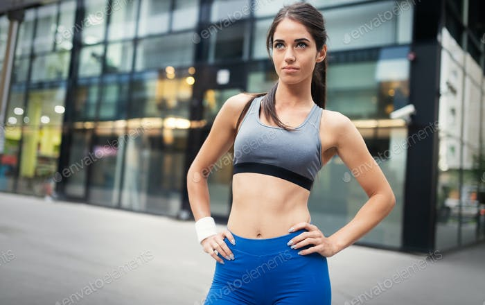 Picture of young attractive happy fitness woman