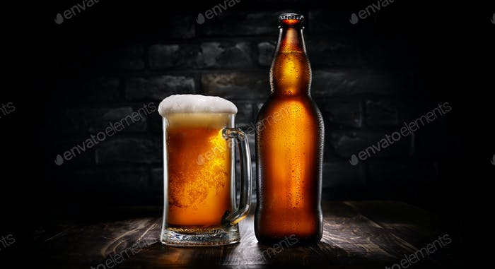 Beer in mug and bottle on black