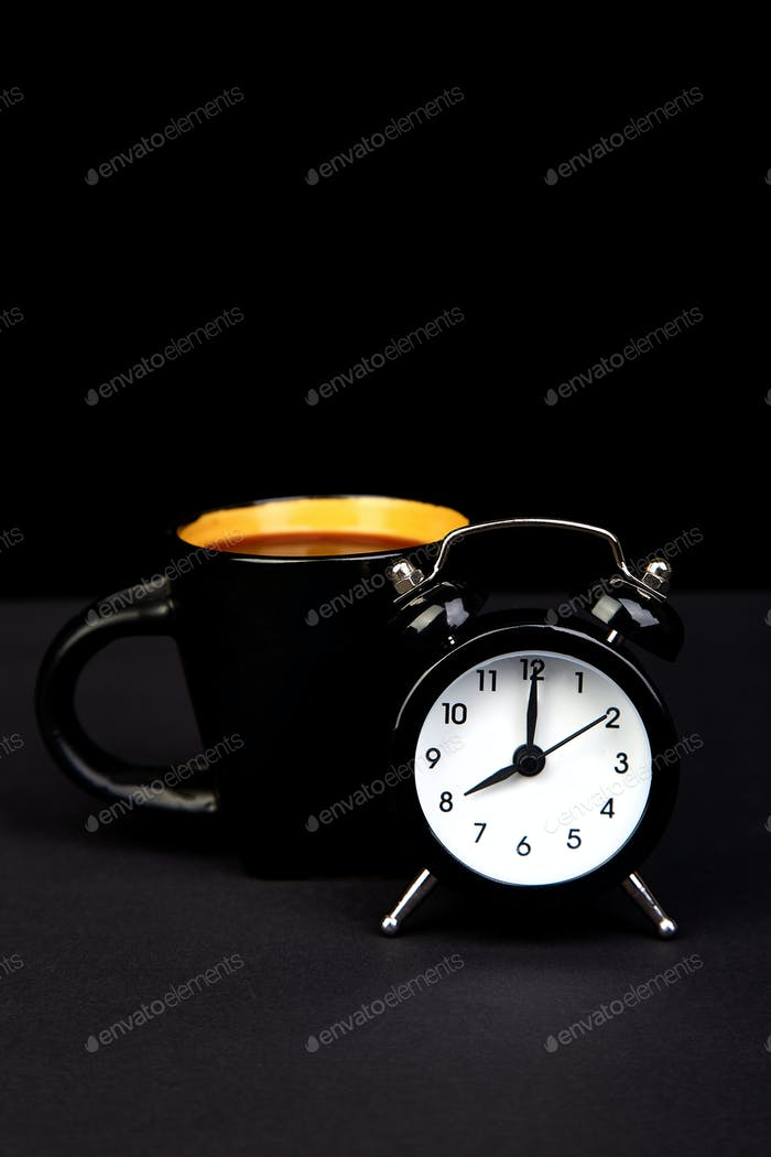 Morning coffee and alarm clock