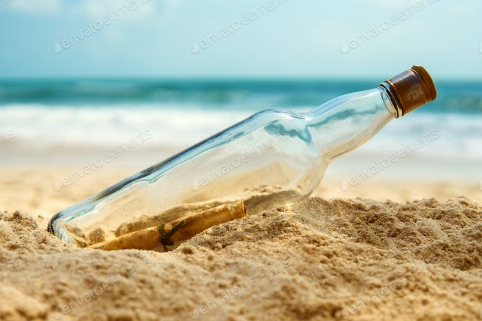 Message In A Bottle On The Shore Of A Desert Island