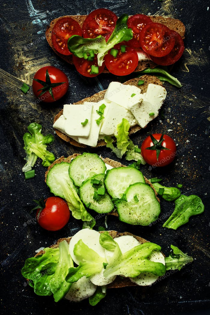 Bruschetta with tomatoes, cucumbers, cheese and lettuce