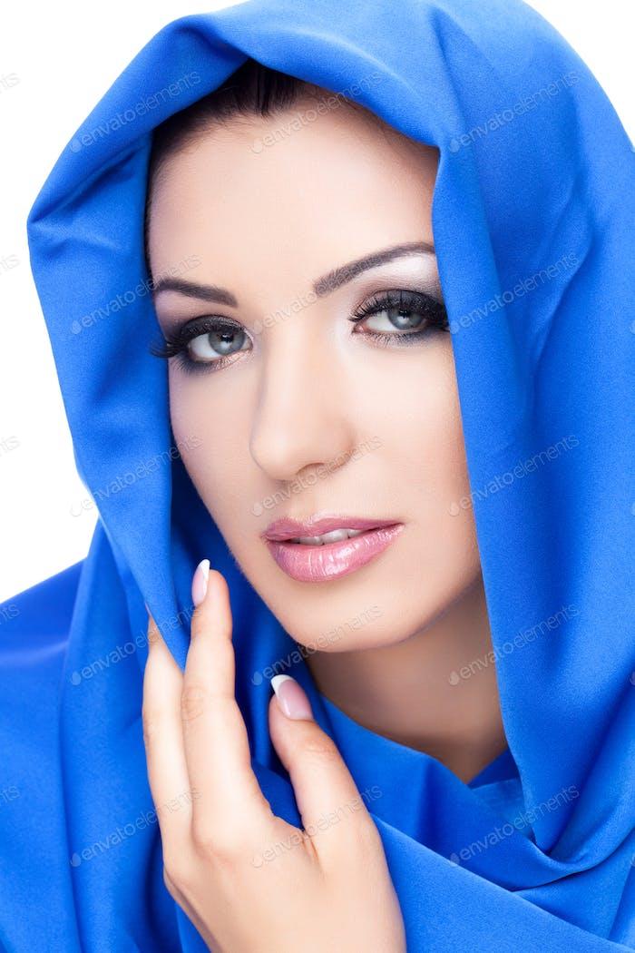Beautiful girl in blue shawl