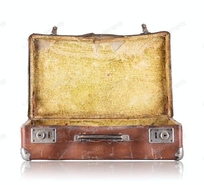 Open old suitcase with yellow upholstery inside