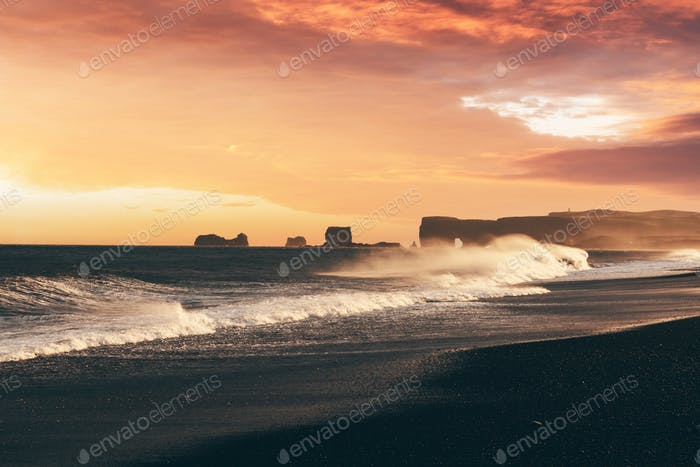Incredible sunset view on stormy Atlantic ocean on Black Beach