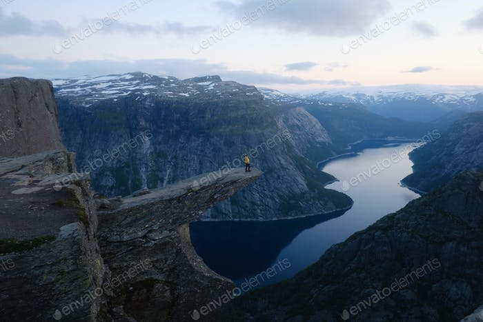 Alone tourist on Trolltunga rock