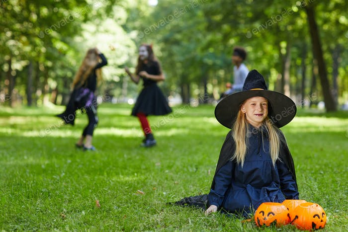 Kids Playing Outdoors on Halloween