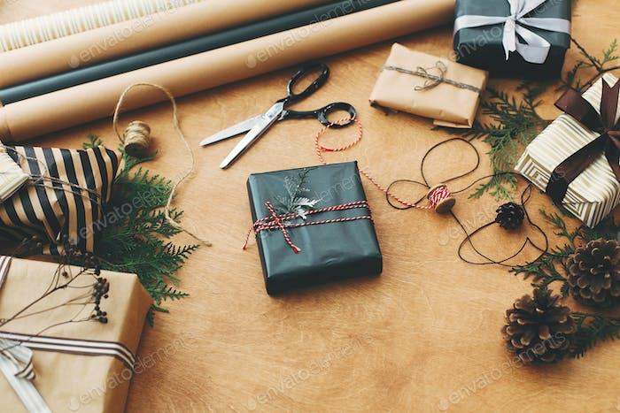 Stylish christmas gift box in black paper. Season's greetings