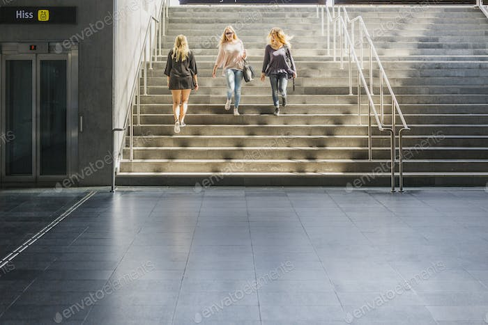 Women walking on stairs